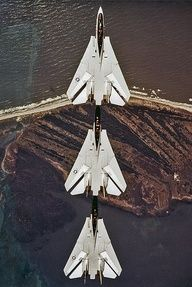 F-14 Tomcats in tight trail formation.
