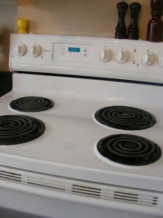How to Clean Cooked-On Gunk from a Stove Top: Mix some baking soda in a small bowl with enough hydrogen peroxide to make a paste. Use a scrubby sponge and the gunk comes off surprisingly easily!