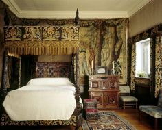 View of King Charles Room at Cotehele, Cornwall, showing bed and tapestries