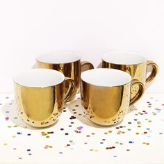 BACK IN STOCK! A lot of you have been asking us about them... Well. They've just landed from Amsterdam! Available as a single mug, or as a set of four. Go forth and bling! http://www.howkapow.com/gold-mug http://www.howkapow.com/gold-mug-set