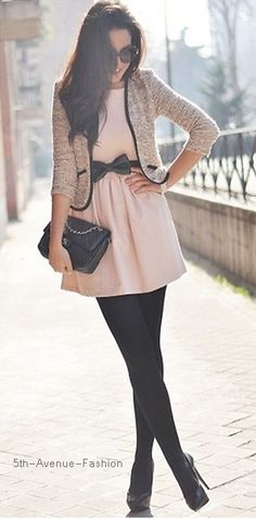 Adorable, tweed jacket with black trim, pink dress with a bow belt, black tights, Black Chanel bag