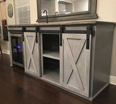 This Grandy sliding barndoor console was delivered and setup today. I built it to accommodate the customer's wine/beer fridge and we installed a @sidebar_beverage_australia liquor dispenser up top. The pub feeling is all coming together in their house!