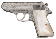 A little something for the desk drawer. Custom engraved Walther PPK. Find our speedloader now! http://www.amazon.com/shops/raeind