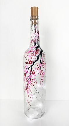 Check out Cherry Blossom Wine Bottle with Fairy Lights at Beer Baron - Paint Nite Hey! Check out Cherry Blossom Wine Bottle with Fairy Lights at Beer Baron - Paint Nite Painted Glass Bottles, Glass Bottle Crafts, Wine Bottle Art, Lighted Wine Bottles, Diy Bottle, Painted Wine Glasses, Decorated Wine Bottles, Bottle Lights, Glass Lights