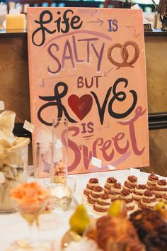 Pink, gold and glitter bridal shower: life is salty but love is sweet dessert table sign | Photo: Robert Madrid Photography