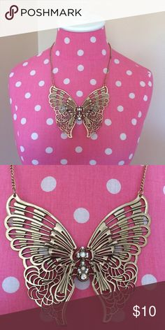 Gold Butterfly Necklace. This statement piece is stunning. Gold colored metal (if you are sensitive to metals know this is not any kind of fancy metal). This necklace can spice up a work outfit or compliment a casual outfit. Works great with solid colors or neutrals. Jewelry Necklaces