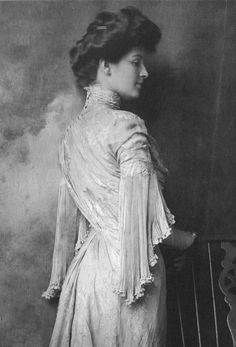 Fashion'' by Harriet Worsley. '' Miss Sedley wears a delicately pleated, draped, high-necked gown, 1903. ''