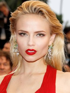 Natasha Poly love the way her hair is styled and love the red. fierce.