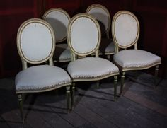 A set of five nineteenth century side chairs in the manner of `Mayhew and Ince. With generous serpentine seats and reeded legs