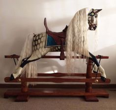 Rare Gamages Bronco rocking horse with his unique serial number retained under his saddle. Beautifully extra carved to include delicate tongue detail. High back saddle unique to the bronco rocking horse which is built in to his back. Believed to date to between 1906 - 1914 Rocking Horse Heaven Antique & Contemporary Rocking Horses