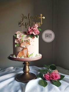Cute christening cake with handpainted fox and sugar roses