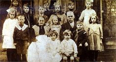 James & Elizabeth Mary Priddey (nee Eglin) & their grandchildren. Alice & Nellie Priddey back left, Arthur Ash, Norman Priddey or Leonard Lane, Ethel Priddey, Jim Priddey in cub uniform, Nellie Ash. Ivy Priddey, ?? Priddey, Grandma, Lilian Priddey, Grandad, Len in cub uniform, Lilian Priddey. Front: Gladys Ash & Wilfred Lane. c1919