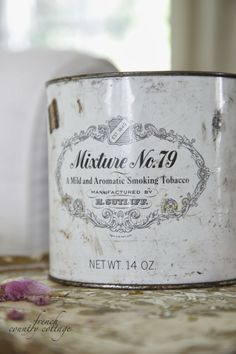 FRENCH COUNTRY COTTAGE: Old tobacco tin vase