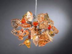 pendant light with shades of Orange color flowers and leaves for hall, bathroom or children room a unique hand made light. Handmade Chandelier, Hanging Chandelier, Chandelier Ceiling Lights, Hanging Pendants, Ceiling Light Fixtures, Pendant Lighting, Flower Chandelier, Orange Color Shades, Shades Of Gold
