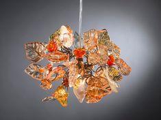 Chandelier lighting. Orange shades of flowers and leaves.. $139.00, via Etsy.