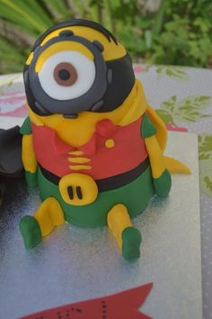 8/29/15 & 9/5/15.  Used as inspiration.  Robin Minion style cake. Perfect with the Batman minion cake