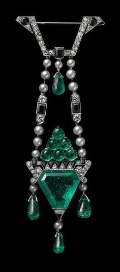 Brooch, Cartier Paris, 1913 Platinum, round old-cut diamonds, one triangular beveled 11.90 carat emerald, emerald cabochons and drop-shaped emeralds, natural pearls, onyx This brooch was exhibited in the Collection of Jewels Created by Messrs Cartier from the Hindoo, Persian, Arab, Russian and Chinese arts at Cartier New York in November 1913.