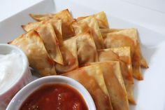 Taco Wontons - Ground beef, melted cheese all wrapped in a crunchy shell.  Perfect little appetizer for guys, girls and kids!