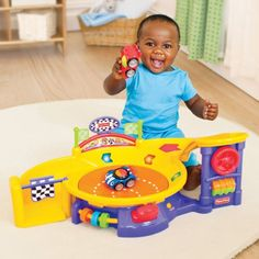 Fisher-Price Lil' Zoomers Spinnin' Sounds Speedway. Recommended age: 6 months - 3 years. Details at http://www.toys-zone.com/fisher-price-lil-zoomers-spinnin-sounds-speedway/