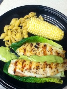 Grilled tilapia for 6 minutes, topped it with a creamy avocado, cilantro, lime dressing I made. With a side of half a corn & a little pasta seasoned with crushed peppers, lemon juice, garlic and chives. Low carb healthy meal :-)