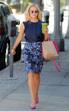 <p>All smiles, Reese slips into a red and navy striped Draper James dress paired with suede blue pumps.</p>
