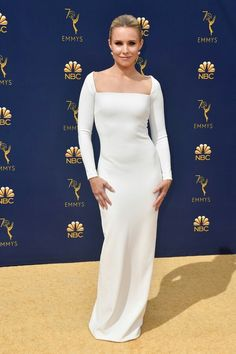 Kristen Bell Wearing a slinky white long-sleeve Solace London column gown  with a sqaure neckline e69a9ab9a