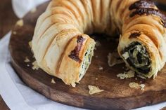If you pull out the Bundt cake pan, you can easily make one giant rolled spanakopita that can be cut into neat slices when you're ready to serve.