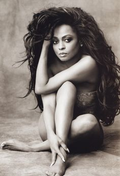 Diana Ross poses with long hair in black and white image