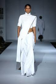A white modern drape - Rishta by Arjun Saluja. Bridelan - a personal wedding shopper & stylist. Website www.bridelan.com #Bridelan #sari