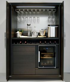 "The theme units are equipped with slide-in hinged doors, called pocket doors. They can be positioned and combined to suit individual wishes in the living area, like this STAGE ""Bar"" or in the kitchen. #Poggenpohl #NewTrend #STAGE"