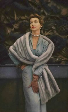 1952 Vogue baby blue wiggle dress and chinchilla stole.
