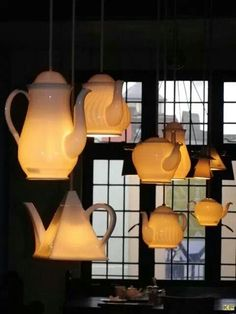 OMG cute. Kettle light fixtures hanging from the ceiling. I love it.