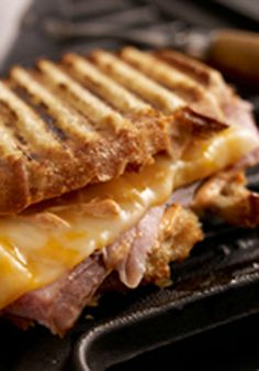 Smoky Grilled Ham and Cheese — Smoky slow-cooked ham and Colby Jack cheese with a paprika-kissed mayo dressing and are grilled to perfection in this tasty sandwich recipe.