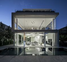"""The Concrete Cut,"" a modern concrete and glass residence in Ramat Gan, Tel Aviv District, Israel. Designed by Pitsou Kedem Architects. Kamala Beach, Pitsou Kedem, Unique Architecture, Prefab Homes, Minimalist Home, Interior Design Inspiration, Design Ideas, Villas, Luxury Homes"