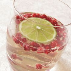 White Sangria with Pomegranate:  1 bottle white wine 3 cans 7up or Sprite Grand Marnier (2-3 oz, to taste) Seeds of 1 pomegranate slices of two limes ice  Pour all ingredients into a punch bowl, wait for the seeds to float, serve.