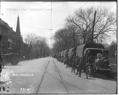 ID# 0347 Date: 1917. Army convoy trucks that crossed the states through Ohio stopped in Oberlin for the night when they could. Women in town served dinner to the soldiers and Warner Gymnasium was used as overnight barracks. Participant: Oberlin College Archives. Additional Sources Used For History:Pictorial Memories of Oberlin, The Rotary Club of Oberlin, 1976 and 1989.