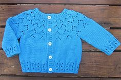The Gift (An Bronntanas in Irish) is a baby cardigan knitted top down. The yoke is knitted first and then stitches are divided for the body and sleeves. The yoke has a decorative lace pattern and the cuffs have an eyelet ribbing for extra interest. Baby Cardigan Knitting Pattern Free, Baby Sweater Patterns, Knitted Baby Cardigan, Cardigan Pattern, Lace Knitting, Baby Patterns, Knit Patterns, Baby Knitting Patterns Free Newborn, Pull Bebe