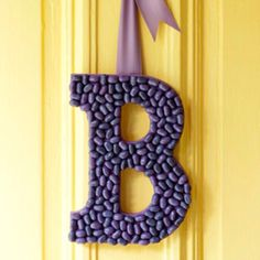 Jelly Bean Door Decor Paint a letter using acrylic paint. Match the paint to the color of the jelly beans. Let the paint dry. Hot-glue the jelly beans to the front of the letter. Let dry. Hot-glue a ribbon to the back for a hanging loop. Holiday Crafts, Holiday Fun, Fun Crafts, Spring Crafts, Front Door Monogram, Leelah, Easter Crafts For Kids, Craft Kids, Easter Ideas