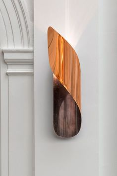 Want - Folded copper wall lights, designed by Champsaur.