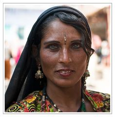gypsy woman.......all Gypsies come out from India and spead across Europe, Some branches were taken as slaves and came up from Egypt and that is how they were given the name Gypsy the E from Egypt was dropped