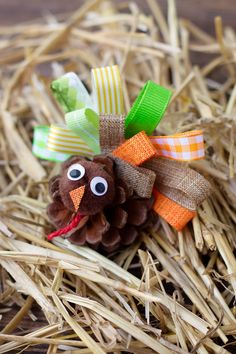 Inside: Just in time for Thanksgiving, learn how to make a fun Pine Cone Turkey Craft for Kids with ribbon, pine cones, and pom poms. It's the perfect fall nature craft for kids! Free Thanksgiving Printables, Thanksgiving Crafts For Kids, Thanksgiving Decorations, Holiday Crafts, Kids Crafts, Thanksgiving Turkey, Leaf Crafts, Pine Cone Crafts, Pinecone Turkey