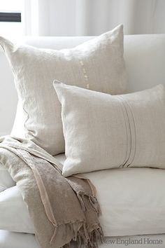 Linen. I love the simple detailing of these cushions. The whole look only adds to the warmth of neutrals. It makes me want to curl up with a book.