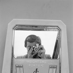 Vivian Maier  -  Self-Portrait, n.d. (reflection in scale mirror) / Silver Gelatin Print  -  12 x 12