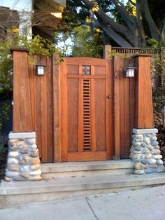 Out of all the cedar fence gate designs out there, this gorgeous, rustic wooden fence is the perfect touch as an entranceway to the garden! Fence gate ideas and design. Craftsman Exterior, Craftsman Bungalows, Craftsman Style, Craftsman Homes, Wooden Garden Gate, Wooden Gates, Wooden Fence, Wooden Doors, Front Door Design