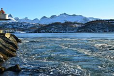 Snow covered mountains in the background, with Saltstraumen bubbling around in the foreground . See more pictures and videos of excotic Northern Norwegian arctic nature at: nordlandnature.com