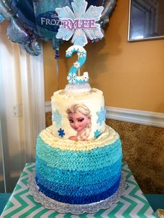 Frozen themed birthday cake for a 5 year old featuring Elsa Olaf