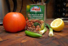 1–Lebanese foul (ful), a mixture of fava beans, tomato, green onion, green chili, lemon, olive oil, garlic, salt and pepper. Fava Beans, Garlic Salt, Green Onions, Olive Oil, Chili, Pepper, Lemon, Breakfast, Food