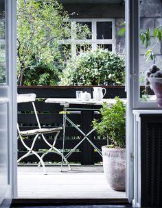 Måske inspiration til forhaven eller en lille terrasse i haven
