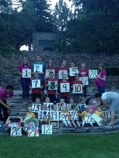 Awesome family reunion picture idea- grandkids with # & they decorate themselves.