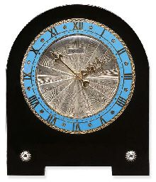 AN ART DECO ENAMEL, BLACK ONYX AND DIAMOND DESK CLOCK, BY CARTIER